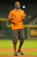 Former Texas Longhorns quarterback Vince Young prepares to throw out the ceremonial first pitch prior to the game between the Texas Longhorns and the Rice Owls at Minute Maid Park on March 2, 2012 in Houston, Texas.  Brian Westerholt / Four Seam Images