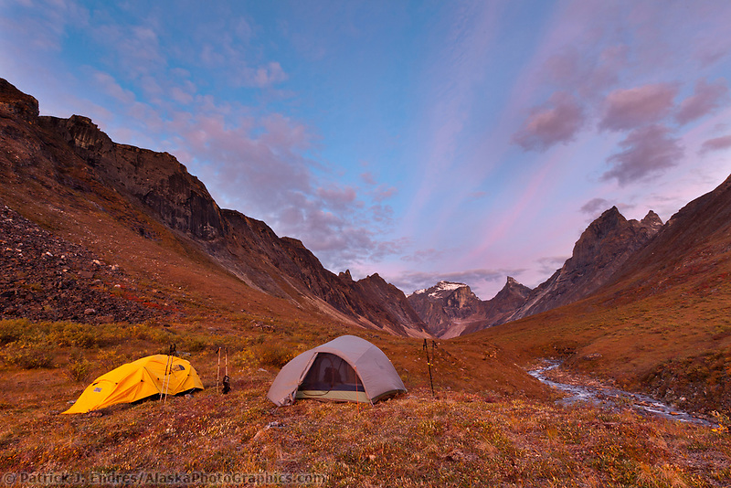 Campsite on a mountain ridge, morning light on Xanadu, Arial and Caliban peaks, Arrigetch creek, Gates of the Arctic National Park, Alaska.