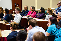 """People listen as New York Assemblyman (79th District) and Vice Chair of the Democratic National Committee Michael Blake speaks to a live audience during a session of Resistance School in the Starr Auditorium in the Belfer Building of Harvard University's John F. Kennedy School of Government, on Thurs., April 27, 2017. Blake's lecture was titled """"How to sustain the resistance long term.""""  The lecture, which was the fourth such session and the final in what the group calls the """"first semester"""" of Resistance School, was also streamed live on the internet. Resistance School was started by progressive graduate students at Harvard after the Nov. 8, 2016, election of President Donald Trump. Resistance School describes itself as a """"practical training program that will sharpen the tools [needed] to fight back at the federal, state, and local levels."""" The live lectures are streamed and archived online alongside other information on the Resistance School website. During the lectures, teams of volunteers engage with followers on social media, including Facebook and twitter, sharing soundbytes, quotations, and supplementary materials as the lectures happen."""