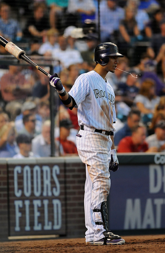 17 AUGUST 2011:  Colorado Rockies left fielder Carlos Gonzalez (5) spits as he swings n the on deck circle   during a regular season game between the Florida Marlins and the Colorado Rockies at Coors Field in Denver, Colorado. The Rockies beat the Marlins 12-5. *****For Editorial Use Only*****