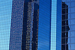 Downtown Bellevue with tall building with reflections off glass exterior Bellevue Washington State USA