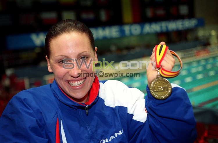 Pix: Ben Duffy/SWpix.com....International Swimming-European Short Course Championships, Antwerp, Belgium.....16/12/2001..COPYWRIGHT PICTURE>>SIMON WILKINSON>>01943 436649>>..Great Britain's Sarah Price with her Gold medal after the Womens 200m Backstroke.