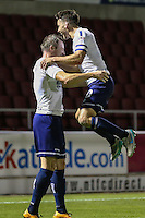 Garry Thompson of Wycombe Wanderers (left) celebrates scoring his team's 2nd goal of the game with Matthew Bloomfield of Wycombe Wanderers (right) during The Checkatrade Trophy match between Northampton Town and Wycombe Wanderers at Sixfields Stadium, Northampton, England on 30 August 2016. Photo by David Horn / PRiME Media Images.