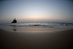 Sunset on the beach at Candolim in Goa in India.