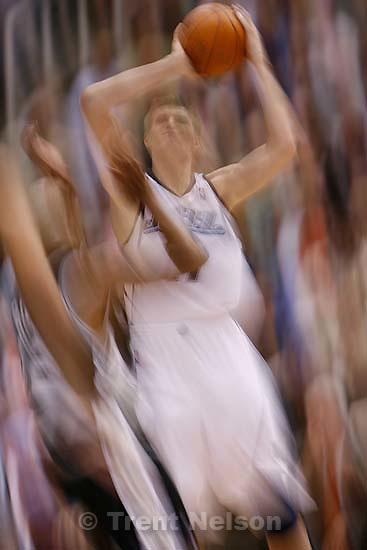 Utah Jazz vs. San Antonio Spurs, (shot on personal time) 4.04.2006 slow shutter.  Andrei Kirilenko.<br />