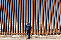 MEXICALI, MEXICO - April 5 An officer of the Mexican Federal Police stands next to the US-Mexico Border Fence on April 5, 2019 in Mexicali, Mexico.<br /> President Trump on Friday visited Calexico, a small city in a largely agricultural region between Arizona and the Pacific, to inspect an upgraded portion of fencing and to meet with law enforcement. That's more attention than usual for a border town that locals say is defined by its interconnection with Mexico, its infernal summers and its labor-based economy. <br /> (Photo by Luis Boza/VIEWpress)