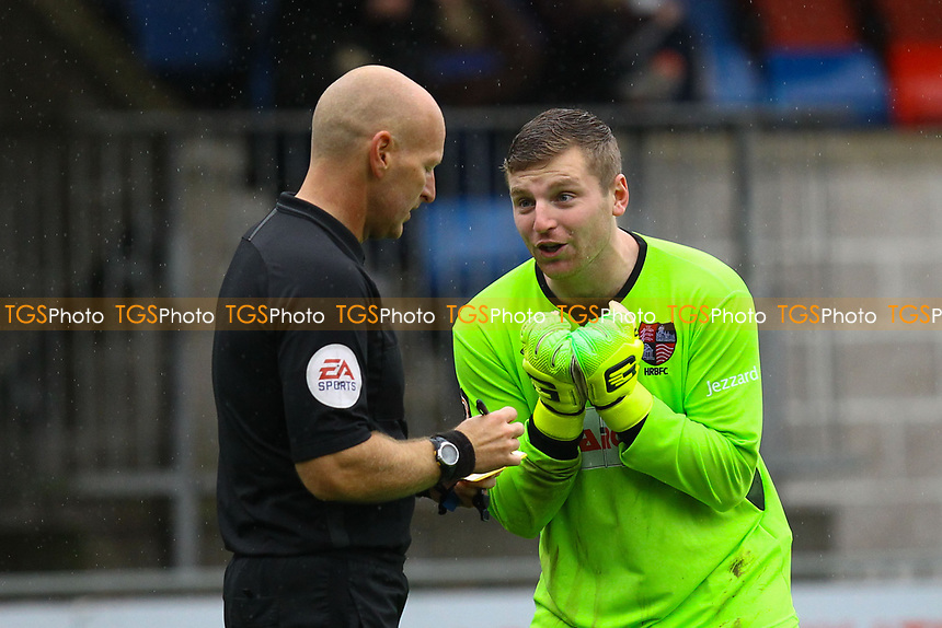 Tom Lovelock of Hampton & Richmond Borough protests to the referee Steven Hughes after he receives a yellow card during Hampton & Richmond Borough vs AFC Hornchurch, Emirates FA Cup Football at the Beveree Stadium on 6th October 2018