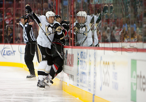 14th October 2009: Penguin Chad LaRose (59) gets checked hard into the boards by Penguin Ruslan Fedotenko (26) during the third period of the Pittsburgh Penguins 3-2 victory over the Carolina Hurricanes in the RBC Center in Raleigh, NC. Photo by Tim Steadman/Actionplus. UK Licenses Only...