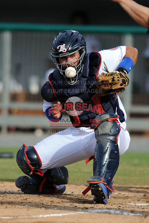 Tennessee Smokies catcher Rafael Lopez #29 attempts to field the ball during game one of a double header against the Huntsville Stars at Smokies Park on July 8, 2013 in Kodak, Tennessee. The Stars won the game 2-0. (Tony Farlow/Four Seam Images)