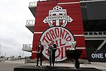08 December 2016: Toronto mayor John Tory (right) makes a speech flanked by Canadian soccer legend Dwayne De Rosario (left) before the press conference. Major League Soccer's Philip F. Anschutz Trophy made an appearance with Toronto's mayor at a press conference outside of BMO Field in Toronto, Ontario in Canada two days before MLS Cup 2016.