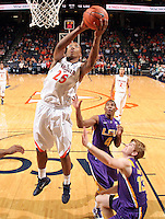 Jan. 2, 2011; Charlottesville, VA, USA; Virginia Cavaliers forward Akil Mitchell (25) shoots over LSU Tigers guard Chris Bass (4) and LSU Tigers forward Eddie Ludwig (13) during the game at the John Paul Jones Arena. Virginia won 64-50. Mandatory Credit: Andrew Shurtleff-