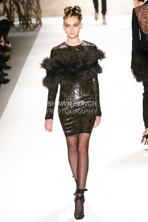 Anya Kazakova walks runway in a Monique Lhuillier Fall 2011 outfit, during Mercedes-Benz Fashion Week Fall 2011.