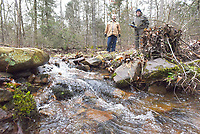 NWA Democrat-Gazette/FLIP PUTTHOFF <br /> Joe Pearson (left) and Spud Westmoreland look at a stream in March 2019 that flows through the Beatrice Johnson Kiwanis Youth Kamp east of Clarksville in Johnson County. There's no charge for youth groups to use the camp, which has several camp spots, trails and a pavilion.