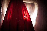 The red veil of an unmarried Kyrgyz girl..Campment of Tash Seri...Trekking with yak caravan through the Little Pamir where the Afghan Kyrgyz community live all year, on the borders of China, Tajikistan and Pakistan.