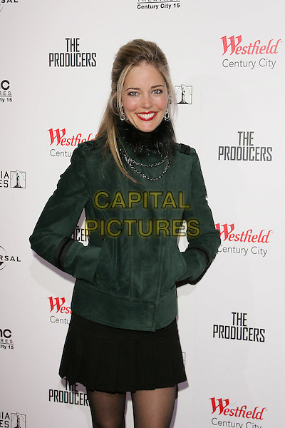 "CHRISTINA MOORE.""The Producers"" World Premiere held at the Westfield Century City, Century City, California..December 12th, 2005 .Photo: William Scott/ AdMedia/Capital Pictures.Ref: WS/ADM.half length hands in pockets black fur collar green jacket skirt.www.capitalpictures.com.sales@capitalpictures.com.© Capital Pictures."