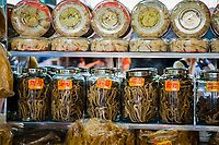 Glasses jars full of dried seahorese for sale at a medicine shop in Guangzhou, China. seahorses are dried for use as aphrodisiacs in Chinese medecine.