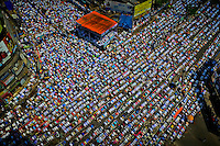 Thousands of Bangladeshi Muslim activists attend Jumma prayer on a road in Dhaka, Bangladesh.