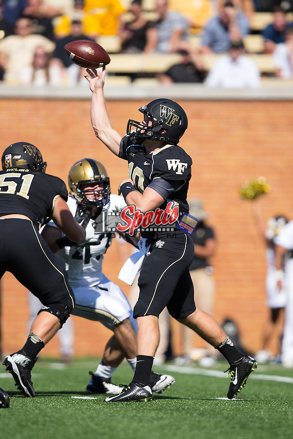 John Wolford (10) of the Wake Forest Demon Deacons passes the ball during first half action against the Army Black Knights at BB&T Field on September 20, 2014 in Winston-Salem, North Carolina.  The Demon Deacons defeated the Black Knights 24-21.  (Brian Westerholt/Sports On Film)