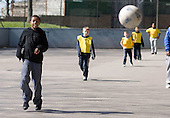 Football training under the Westway, part of 'Unity in the Community', a programme of activities during school holidays based at the nearby newly built Stowe Centre, on the Harrow Road in West London.  The centre is run by Paddington Development Trust.