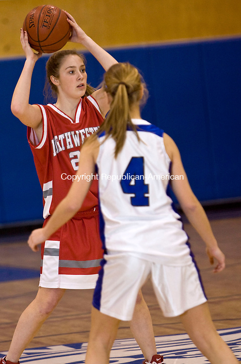 BURLINGTON, CT - 08 JANUARY 2009 -010909JT09-<br /> Northwestern's Sarah Raftery looks for a pass while under pressure from Lewis Mills' Nicole Bisson during Friday's game at Lewis Mills. Northwestern won 43-40 in overtime.<br /> Josalee Thrift / Republican-American