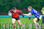 Gavan O'Grady Glenbeigh/Glencar goes past Peter Crowley Laune Rangers during the Mid Kerry Championship final in Beaufort on Saturday