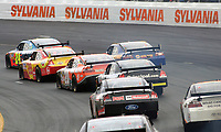 14 September 2008--A pack of cars races through a turn during the Sylvania 300 at New Hampshire Motor Speedway in Loudon, NH.  (Brian Cleary/BCPix.com)