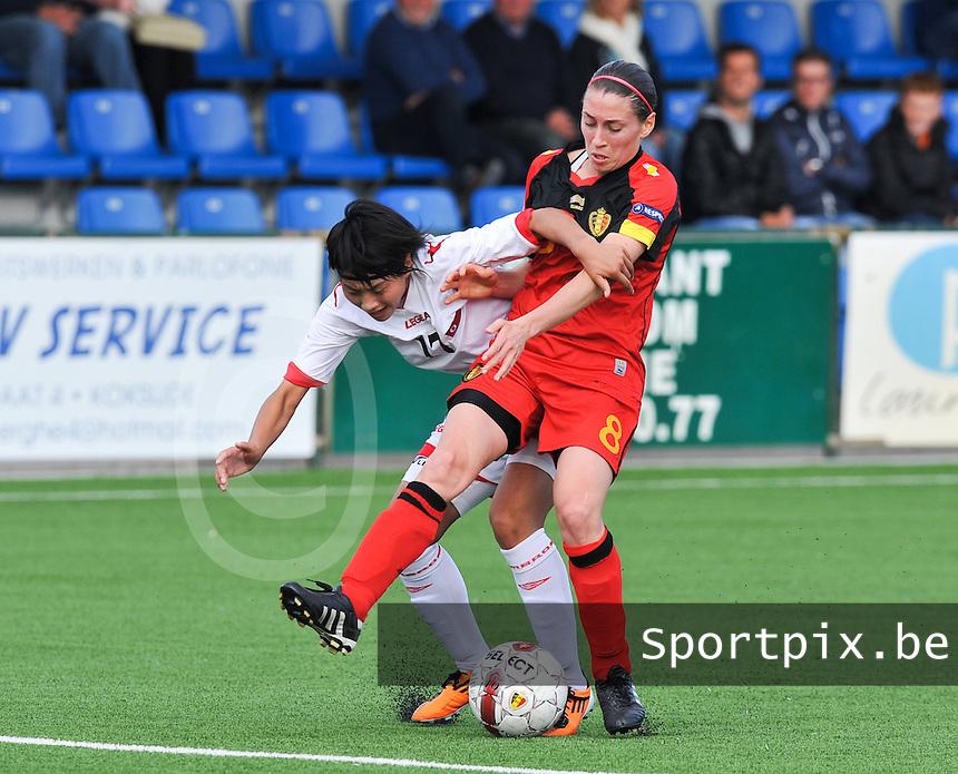 Belgium A - North Korea friendly game at Koksijde KVV Stadium - Belgie - Noord Korea :  Audrey Demoustier in duel met 17. Kim Un Hyang .foto David Catry / Joke Vuylsteke / Vrouwenteam.be
