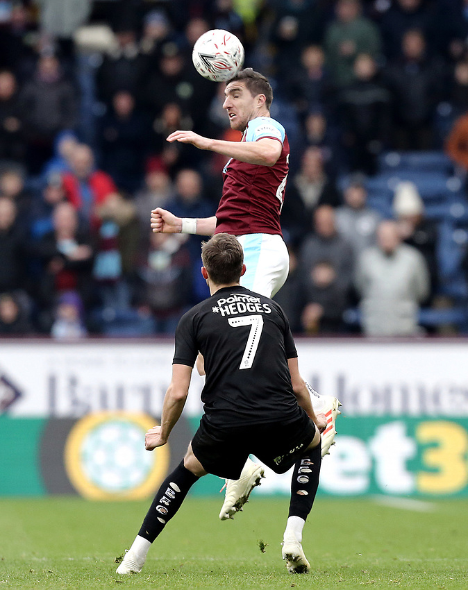 Burnley's Stephen Ward wins an aerial ball despite the attentions of Barnsley's Ryan Hedges<br /> <br /> Photographer Rich Linley/CameraSport<br /> <br /> Emirates FA Cup Third Round - Burnley v Barnsley - Saturday 5th January 2019 - Turf Moor - Burnley<br />  <br /> World Copyright © 2019 CameraSport. All rights reserved. 43 Linden Ave. Countesthorpe. Leicester. England. LE8 5PG - Tel: +44 (0) 116 277 4147 - admin@camerasport.com - www.camerasport.com
