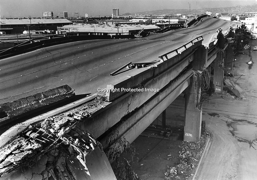 Vioew of the collapsed double-decked Cypress freeway in Oakland, Ca Oct 17,1998 following huge Loma Prieta earthquake. The quake pancaked the upper deck on to the lower. (photo by Ron Riesterer)<br />