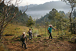 GUATEMALA  --  FEBRUARY 4, 2007:   Two men and a boy walk up a trail to cut down a tree on a hillside overlooking Nebaj on  February 4, 2007 in Guatemala.  (PHOTOGRAPH BY MICHAEL NAGLE)