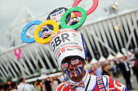 27.07.2012. London England.  A man with aunion jack painted on his face arrives for the olympic opening ceremony in London, Great Britain, 27 July 2012.