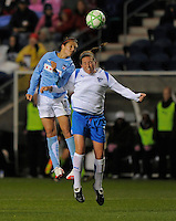 April 25, 2009 Boston Breakers vs. Chicago Red Stars--#10 Carli Lloyd of the Chicago Reds Stars and #17 Kasey Moore of the Boston Breakers go for the ball during their match. Red Stars win the match 4-0.