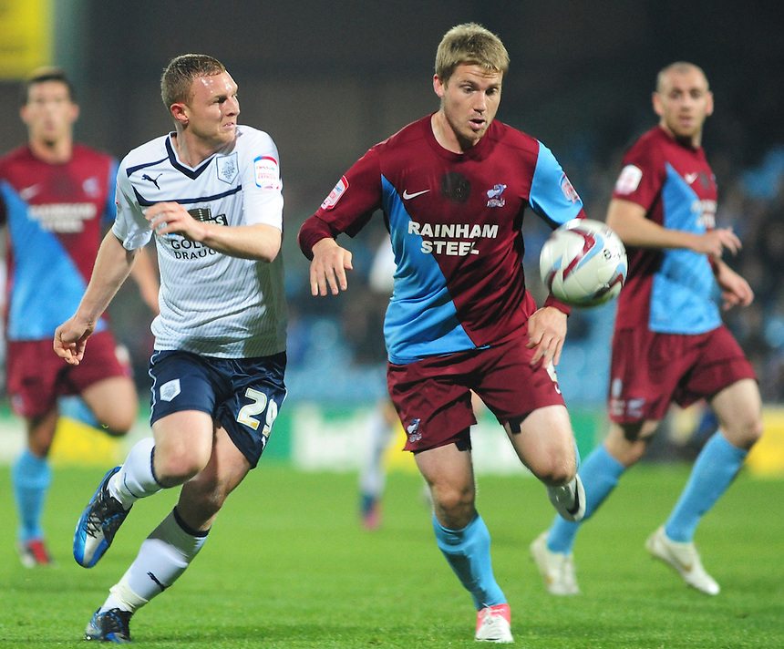 Preston North End's Stuart Beavon vies for possession with Scunthorpe United's Christian Ribeiro ..Football - npower Football League Division One - Scunthorpe United v Preston North End - Tuesday 23rd October 2012 - Glanford Park - Scunthorpe..