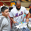 Amed Rosario, New York Mets rookie shortstop, helps Lazaro Negron, Jr. pick out clothes during the team's Holiday Shopping Spree at Target in Elmhurst, NY on Wednesday, Nov. 29, 2017.