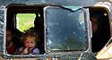 Syria 2014     <br /> August 10, a little girl in a bus with other Yezidi refugees near the bridge of Pesh Kabur before entering Iraq  <br /> Syrie 2014  <br /> Petite fille Yezidi en pleurs a la fenetre d'un autobus  de refugies Yezidis pres du pont de Pesh Kabur