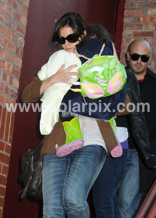 **ALL ROUND PICTURES FROM SOLARPIX.COM**.**SYNDICATION RIGHTS FOR UK, AUSTRALIA, DENMARK, PORTUGAL, S. AFRICA, SPAIN & DUBAI (U.A.E) ONLY**.Tom Cruise wife Katie Holmes and Suri Cruise  Departing a Joyce Theatre Ballet Performance in New York USA..This picKatie Holmes and Suri Cruise..JOB REF: 10299    PHZ/mayer    DATE: 22.11.09.**MUST CREDIT SOLARPIX.COM OR DOUBLE FEE WILL BE CHARGED**.**MUST NOTIFY SOLARPIX OF ONLINE USAGE**.**CALL US ON: +34 952 811 768 or LOW RATE FROM UK 0844 617 7637**