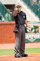 Home plate umpire Brian Miller makes a strike call during the South Atlantic League game between the Kannapolis Intimidators and the Greensboro Grasshoppers at NewBridge Bank Park on May 16, 2012 in Greensboro, North Carolina.  The Grasshoppers defeated the Intimidators 10-8 in 11 innings.  (Brian Westerholt/Four Seam Images)