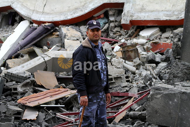 A Palestinian policeman inspects destruction after an Israeli air strike on a building in the northern Gaza Strip refugee camp of Jabalia on March 12, 2012. Israel launched a spate of air strikes killing at least two Palestinians, medics said, after Premier Benjamin Netanyahu vowed no let-up against rocket-firing militants. Photo by Ashraf Amra