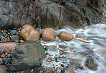 Acadia National Park, Maine: Rounded boulders, rocks and surf at Hunter's Beach, detail