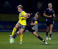 Abby Wambach (20) of the Washington Freedom tries to take the ball away from Joanna Lohman (17) of the Philadelphia Independence during their game at the Maryland SoccerPlex in Boyds, Maryland.  The Washington Freedom defeated the Philadelphia Independence, 2-0.