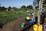 World Water Day. Women are drawing water from the well of a village on the way to Kerteibe Tambakunda