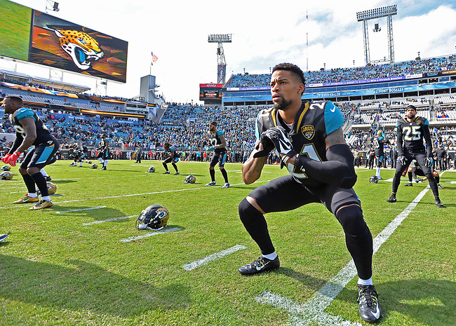 Jacksonville Jaguars cornerback A.J. Bouye (21) stretches before kickoff against the Buffalo Bills in a NFL Wildcard Playoff game Sunday, January 7, 2018 in Jacksonville, Fl.  (Rick Wilson/Jacksonville Jaguars)