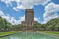 This is the Houston City Hall with the nice reflection fountain in front of it along with some nice cloud and sky on this summer day in downtown. The area is landscaped so it is in a park like setting called the Hermann Square which was name after a real estate  investor, called George H Hermann.  You can come and enjoy the area as it has many benches around the area.