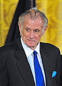 Sportswriter Frank Deford listens as the citation is read as he waits to be presented the 2012 National Medal Humanities Medal by United States President Barack Obama, center, during the presentation ceremony in the East Room of the White House in Washington, D.C. on Wednesday, July 10, 2013.<br /> Credit: Ron Sachs / CNP