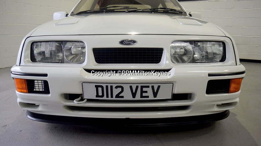 BNPS.co.uk (01202 558833)<br /> Pic: PPMMiltonKeynes/BNPS<br /> <br /> Wide boy with a bit of attitude. <br /> <br /> A pre-production prototype of the legendary Ford Sierra Cosworth RS500 has emerged for sale for a whopping £120,000.<br /> <br /> The RS500 was the road going version of Ford's iconic rally car with only 500 built in order to meet racing regulations.<br /> <br /> This one was the very first to be built in 1987 and in more recent times was road tested by Richard Hammond on the Grand Tour.
