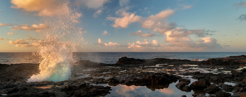 Spouting Horn blow hole at sunrise. Kauai, Hawaii
