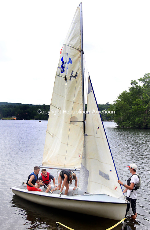 MIDDLEBURY CT. 19 June 2017-061917SV01-From left, Brayden Green, 11, Luke Cenatiempo, 11, and Kelly Buban, 10, all of Woodbury get launched by Instructor Charlie Baywood of Woodbury during sail class at Quassapaug Sailing Center in Middlebury Monday.<br /> Steven Valenti Republican-American
