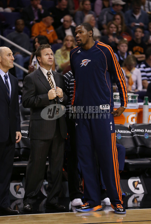 Feb. 10, 2013; Phoenix, AZ, USA: Oklahoma City Thunder small forward Kevin Durant (right) talks to head coach Scott Brooks against the Phoenix Suns at the US Airways Center. Mandatory Credit: Mark J. Rebilas-