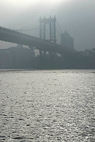 THIS IMAGE IS AVAILABLE EXCLUSIVELY FROM GETTY IMAGES.....Please search for image # 77184629 on www.gettyimages.com....Manhattan Bridge and East River, Sun Breaking thru Morning Fog, New York City, New York State, USA