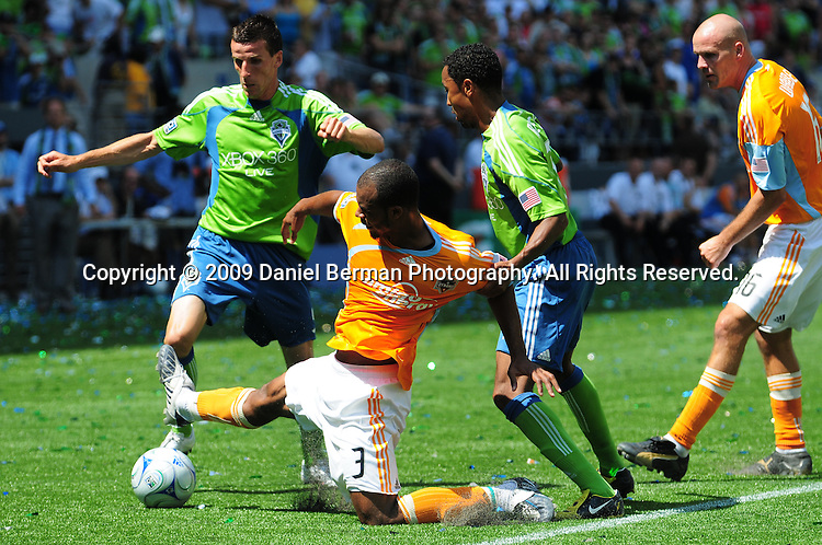 The Seattle Sounders' Sebastien Le Toux, left, and teammate James Riley take down the Houston Dynamo's Julius James in the second half of their match Saturday July 11, 2009 at Qwest Field. ..MKM/